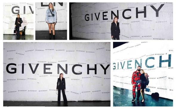 Pose devant un mur d'affichage sauvage du défilé Givenchy